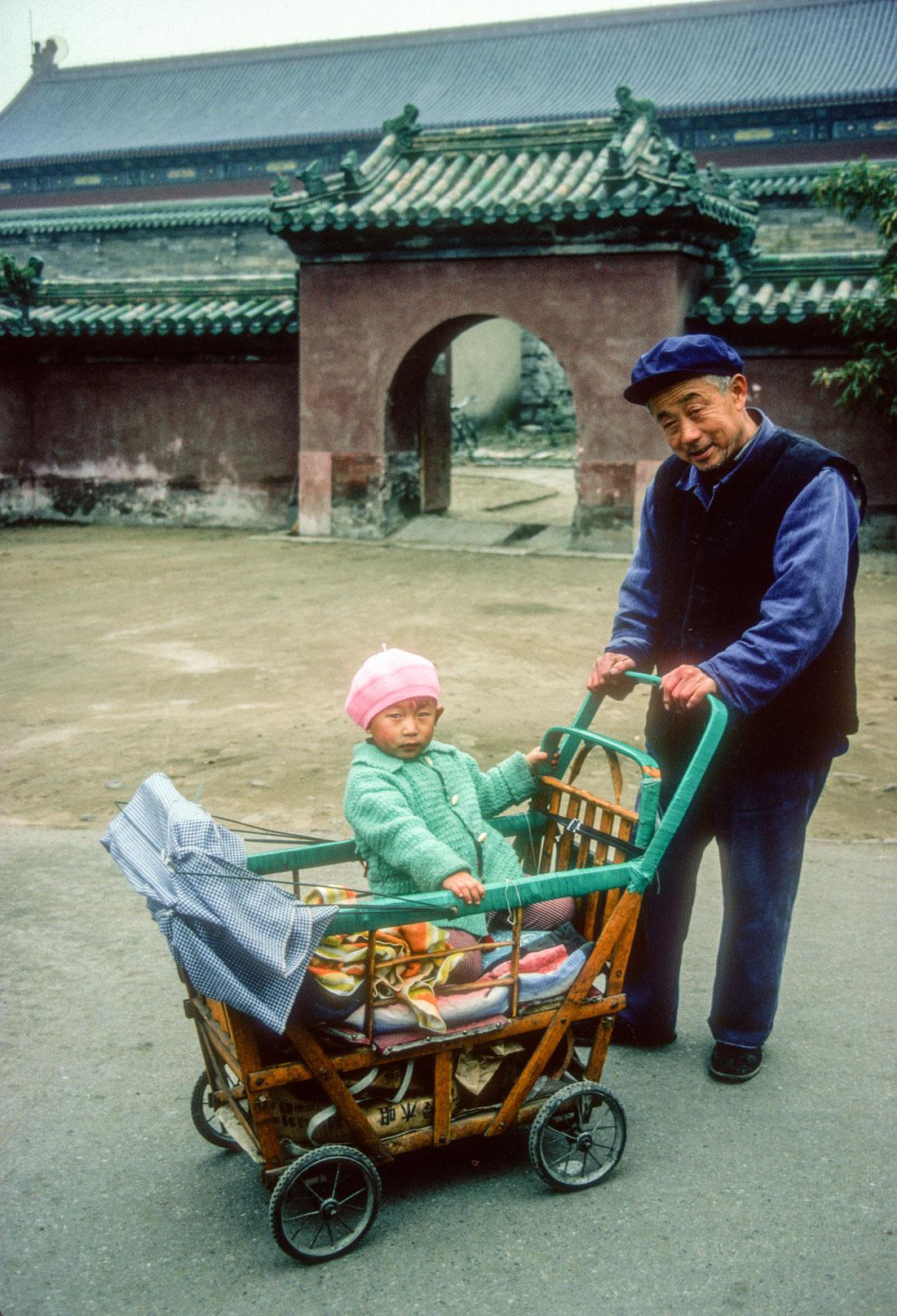 Grandfather and grand child, Beijing, China